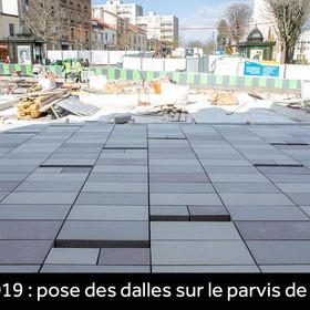 Pose des dalles sur le parvis de la mairie en mars 2019